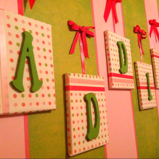 fabric covered canvas with painted wood letters