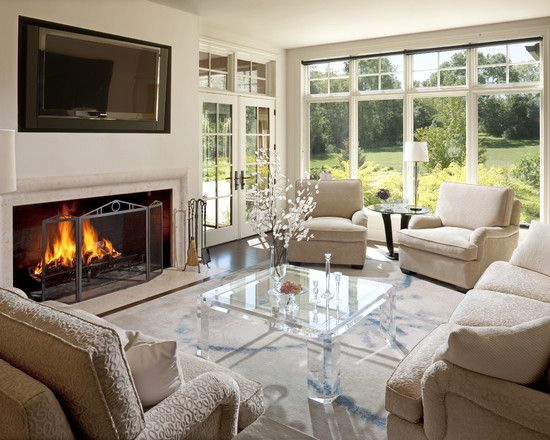 Cozy Country Home Living Room With Acrylic Coffee Table And Cream Sofa