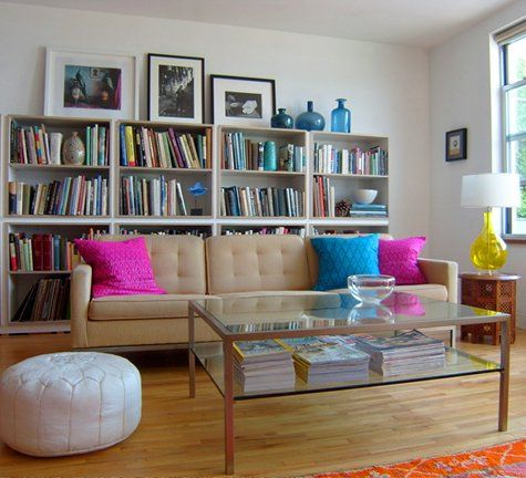 layering furniture.. bookcase behind couch
