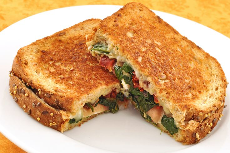 ... goat cheese, prosciutto, sautéed spinach & onion on whole grain bread