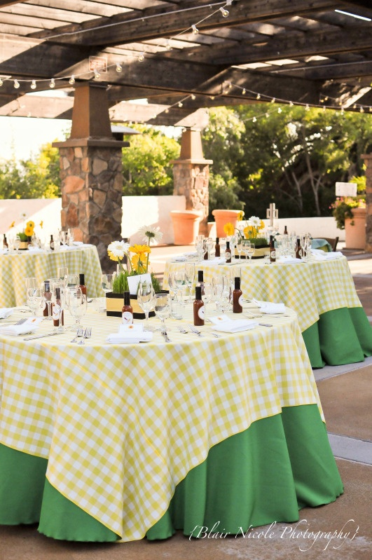 gingham tableclothes would pick up the 'summer picnic' feel - plus yellow is a perfect summer colour. Perhaps add pinks and greens to soften it?