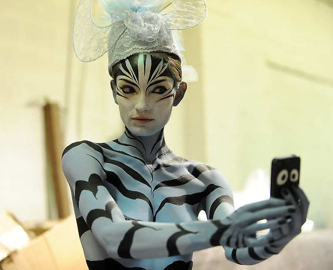 Body painting model alexis broker photographs herself before the show