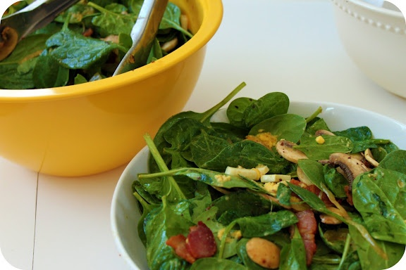 Warm spinach salad with bacon, pecan, and tomato