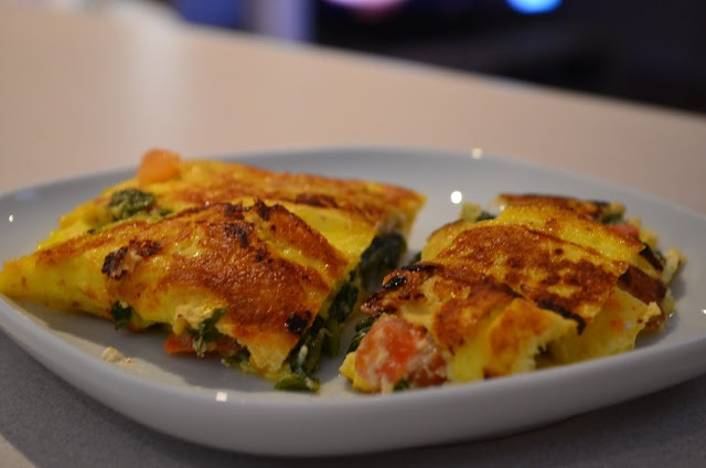 Tomato, spinach and feta cheese omelette.