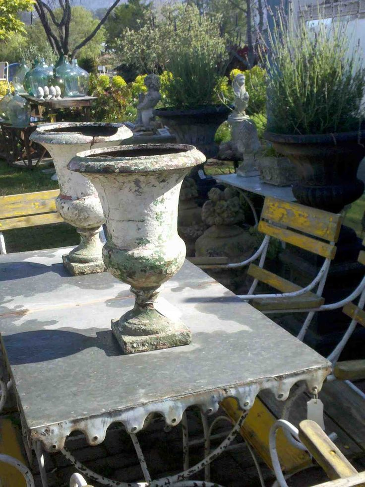 ATELIER DE CAMPAGNE: Jardinières.  19th century garden urns found south west of Paris, on table from Avignon, France