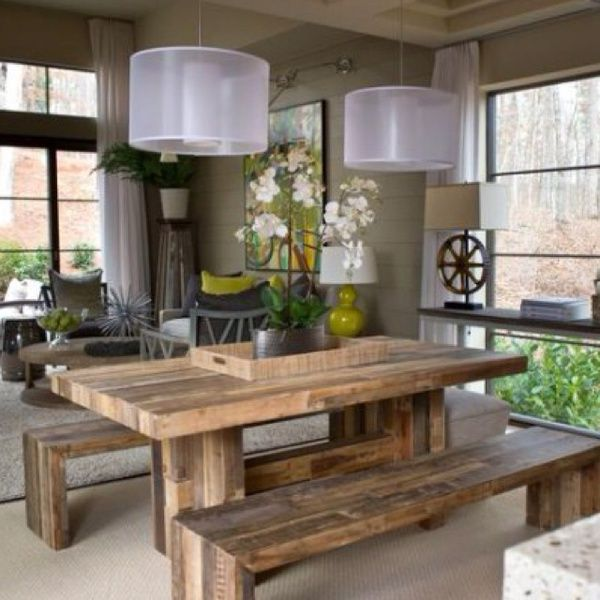 Love the rustic table mixed with modern lighting and color palette