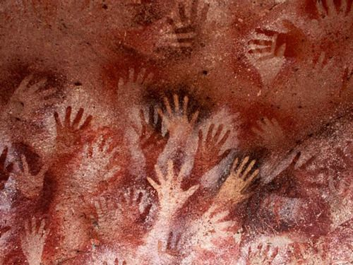 Paleolithic hand stencils from the cave at Lascaux, France. 25-30,000 years old. covered in the ghosts of bloody hands that have long since disintegrated