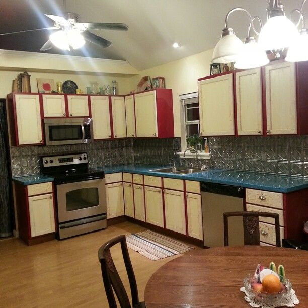 diy kitchen Cre8stone turquoise counters Crackle red cabinets