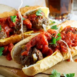 meatballs stuffed inside a mini baguette with mature cheddar and spicy ...