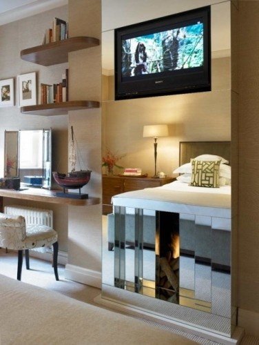 Ummm...is this a fantasy, or an actual mirrored fireplace with an inset flatscreen? Who cares what else is going on in the room after seeing that?