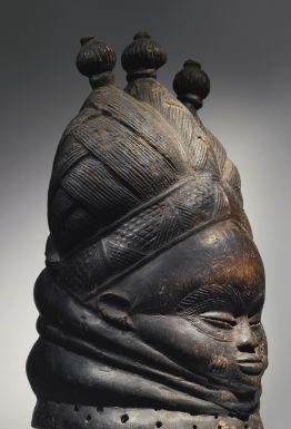 """Mende Ndoli Jowei Helmet Mask, Sierra Leone. notes: """"The Mende term ndoli jowei means 'expert in dance' and is the term used for the individual who performs with the principal mask of the women's society known as the sande.  This type of mask is more frequently, and less accurately, known as a 'Sande' or 'Bundu' mask."""""""