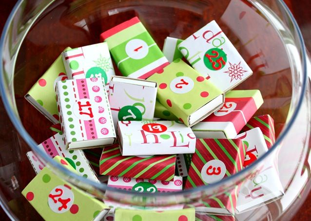 :3 Match boxes covered in Christmas Paper with Family Activities inside.