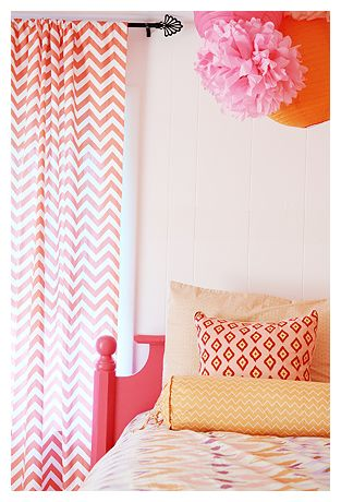 Love the mix + match prints of this coral and orange girls room!
