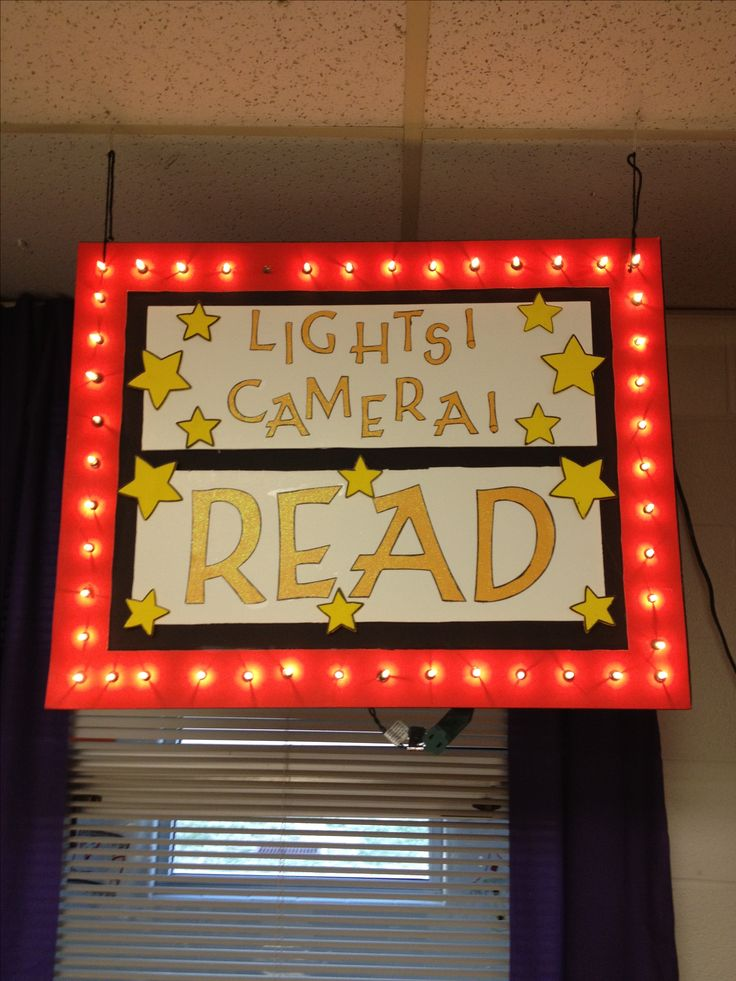Foam board reading corner sign with lights.