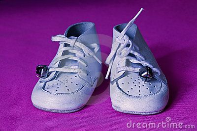 White baby shoes with the                   bells