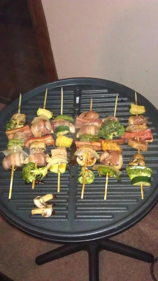 Chicken wrapped in bacon shish kabobs. With ginger sesame sauce one ...