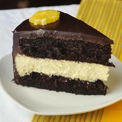 Chocolate Orange Cheesecake Layer Cake - an orange cheesecake sits ...