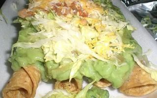 Robertos Taco Shop - 3 rolled tacos with guac!