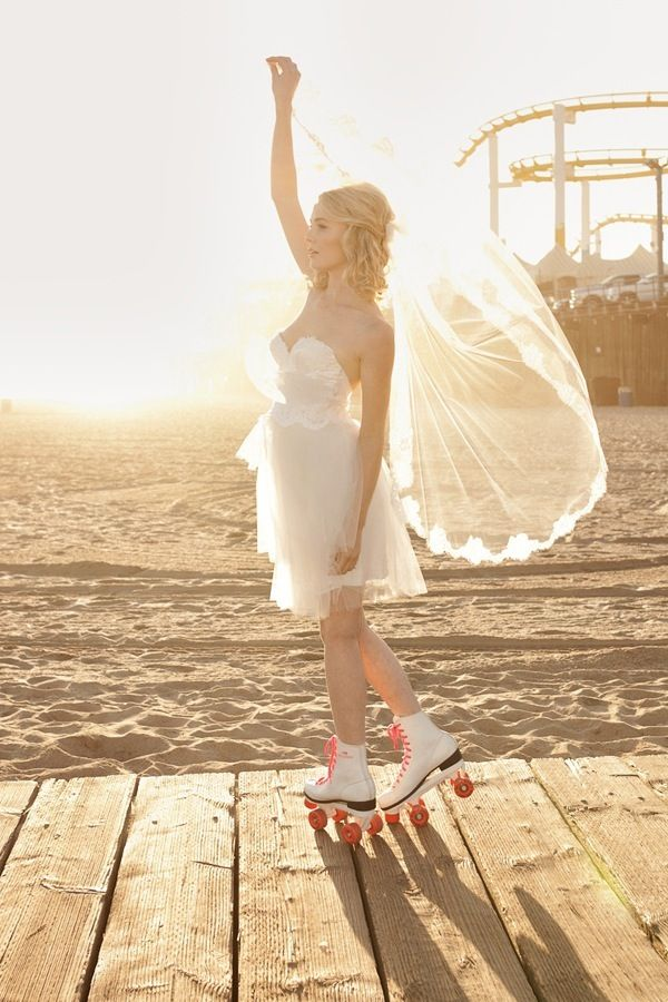 a bride in roller skates!!! (photo by Sweet Little Photographs)