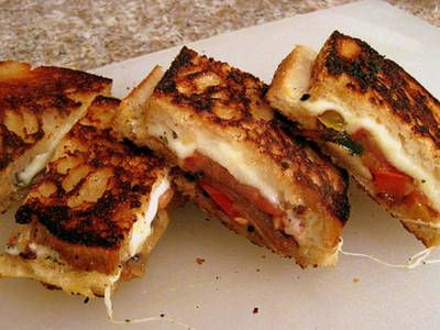 Grilled cheese sandwich with fresh basil and sauteed onions, peppers ...