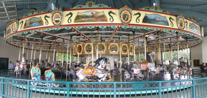 1914 PTC #33 Carousel, Como Park, St.Paul, Minnesota, USA. One of the finest examples of the classic carved wood horse carousels in existence. The carousel has been beautifully restored and is kept in superb condition. The horses are all predominantly grey. The 30-ton carousel has a platform 50 feet across. © Steve Grooms. Date of picture: 17 September 2005.