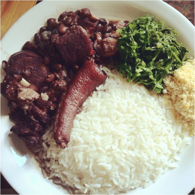 Feijoada, a Brazilian bean stew. always with rice and greens.
