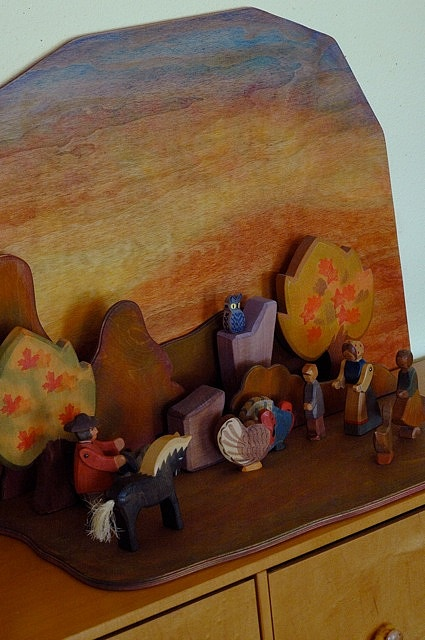I love WaldorfMama's wooden backdrops fr her nature tables
