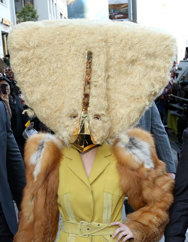 Believe it or not, there's a fame monster under there. Lady Gaga covers up in chilly Berlin on Oct. 24