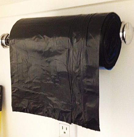 Get ready for all those fall leaves by having your  recyclable trash bags within easy reach on a repurposed towel rack.