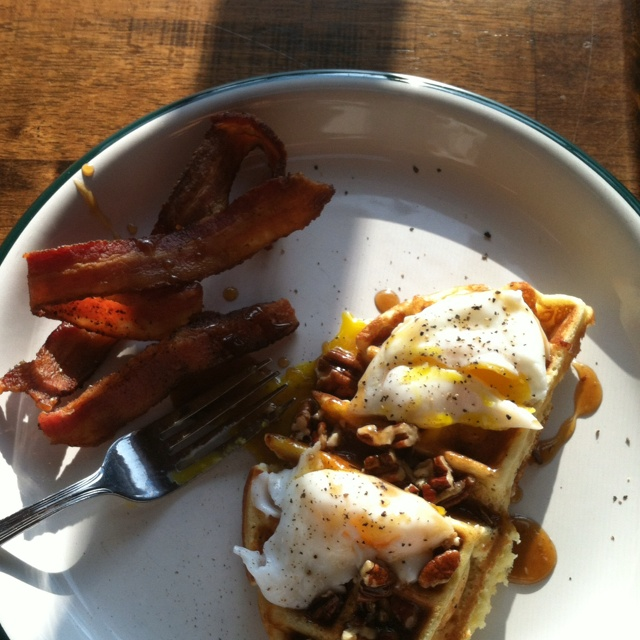 Waffles with praline maple syrup topped with poached eggs. You can use ...