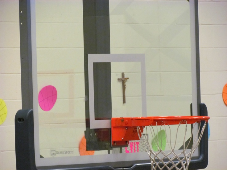 at a basketball game and saw the cross through the back board. there ...