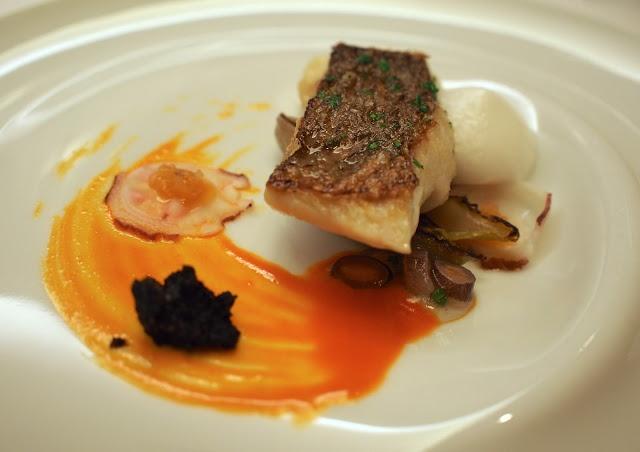 ... onions, paprika marmalade, braised endive, barnacles tarama and black
