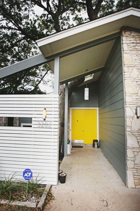 Gray siding, white trim, yellow door