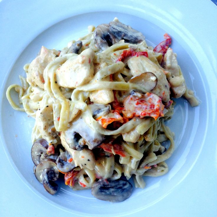 ... CHICKEN, SUN DRIED TOMATOES, AND MUSHROOMS IN WHITE WINE CREAM SAUCE