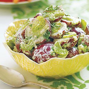 Combine cooked new potatoes with chopped celery, shallots and parsley and dress with a mixture of mayonnaise and mustard for a creamy, tangy potato side dish salad.