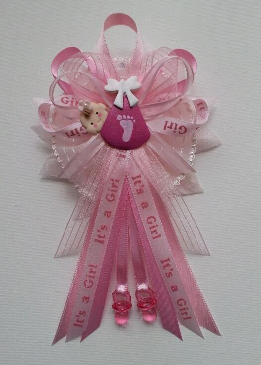 baby shower corsage with baby in pink swaddle