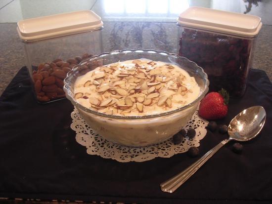 ... yogurt. Sprinkle whole grain, top with rest of yogurt and add sliced