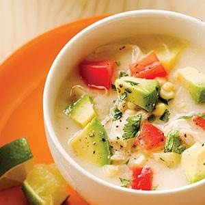 Chicken and corn summer chowder topped with garden tomatoes, avocado ...