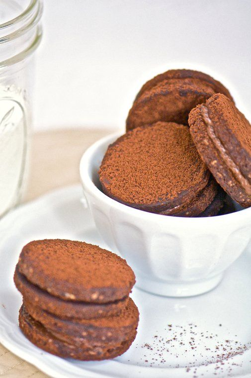 Cocoa Hazelnut Sandwich Cookies...the filling has dark chocolate and ...