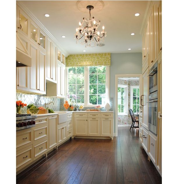 This blue cream tangerine kitchen is lovely and timeless kitchen