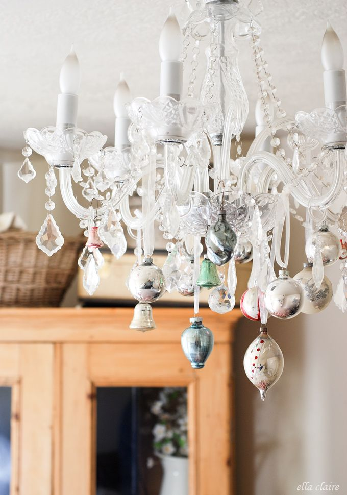 Vintage ornaments hanging from chandelier (Ella Claire Inspired)  | Friday Christmas Favorites at www.andersonandgrant.com