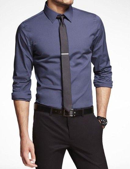 Dark blue shirt. Skinny black tie and clip.