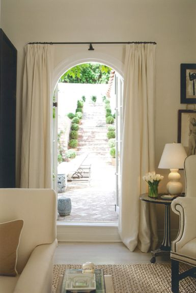 curtains to flank a doorway...nice touch of elegance