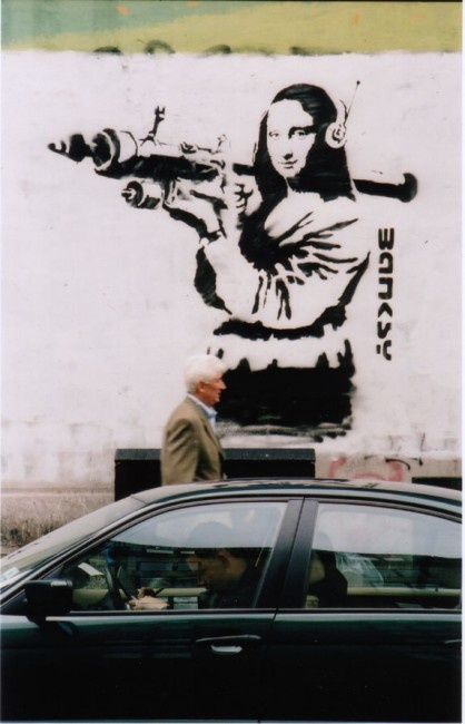 Graffiti artist banksy unmasked as a former public for Banksy mural sold