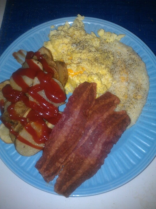 Turkey bacon,scrambled eggs with colby cheese, grits w/american cheese ...