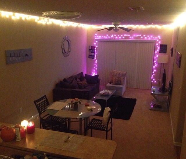 College apartment living room I can do without the pink lights but it
