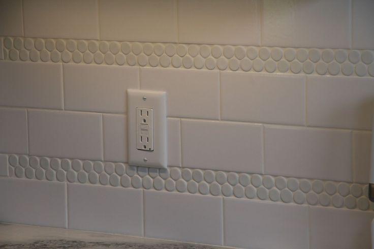 penny tile and subway tile back splash black white