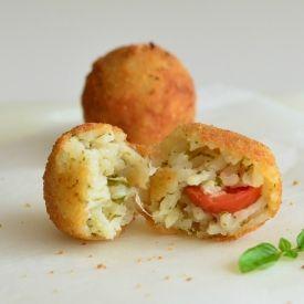 ... risotto rice balls stuffed with buffalo mozzarella, basil and cherry