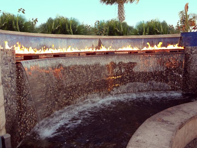 Fire and water wall restaurant design pinterest for Fire pit water feature combo