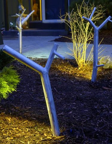 LED newGROWTH custom-built outdoor lighting incorporates low voltage, waterproof LED bar lights and spots. Designed by Christopher Poehlmann for CP Lighting. www.cplighting.com